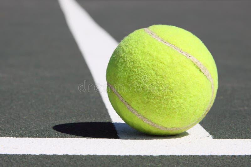 Tenis ball on white line stock photo