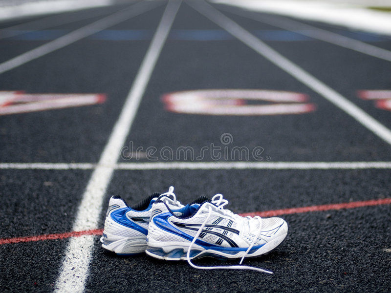 Tenis on the race stock photography