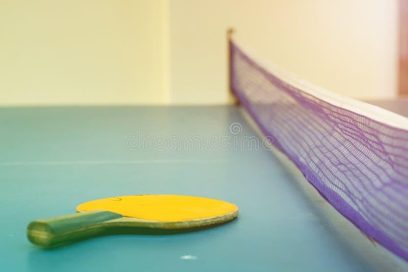 Tennis table and racket. Tenis table and racket with sunset light stock photo