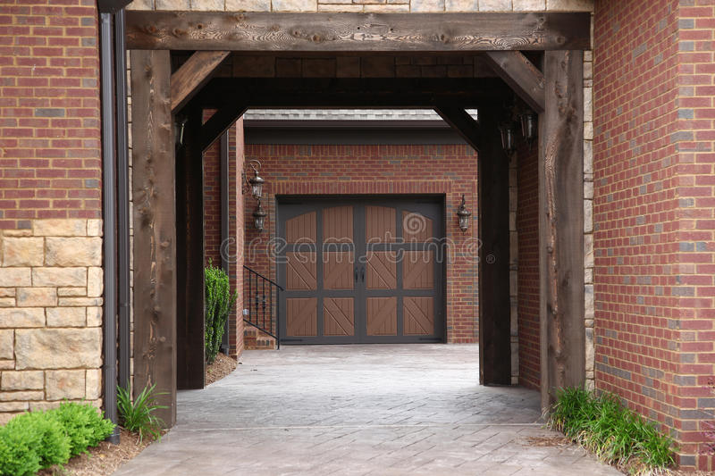 Tennesee Home Breezway to Garages. Image of a million dollar modern middle Tennessee Home. Drivethrough breezeway to garages stock image