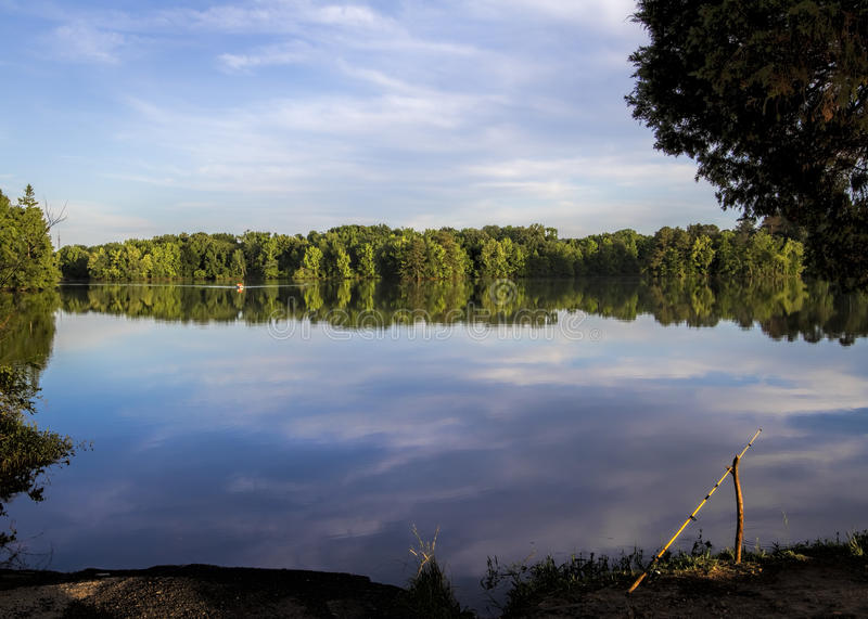 Tennessee River and Fishing Pole. This is the Tennessee River near Decatur Alabama USA with a propped up fishing pole on the bank stock photos