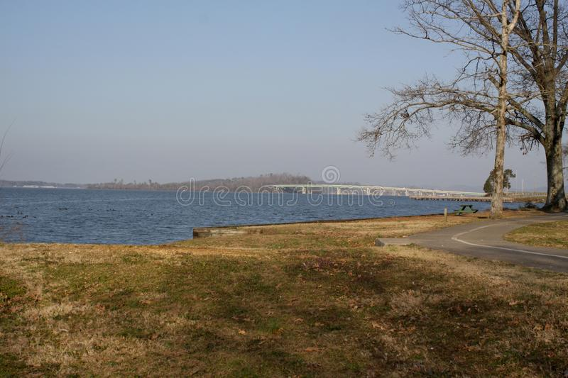 Tennessee river, Guntersville, Alabama. Tennessee river in Guntersville, Alabama. blue sky water trees bike path brown royalty free stock photography