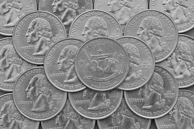 Tennessee State and coins of USA. Pile of the US quarter coins with George Washington and on the top a quarter of Tennessee State royalty free stock photography