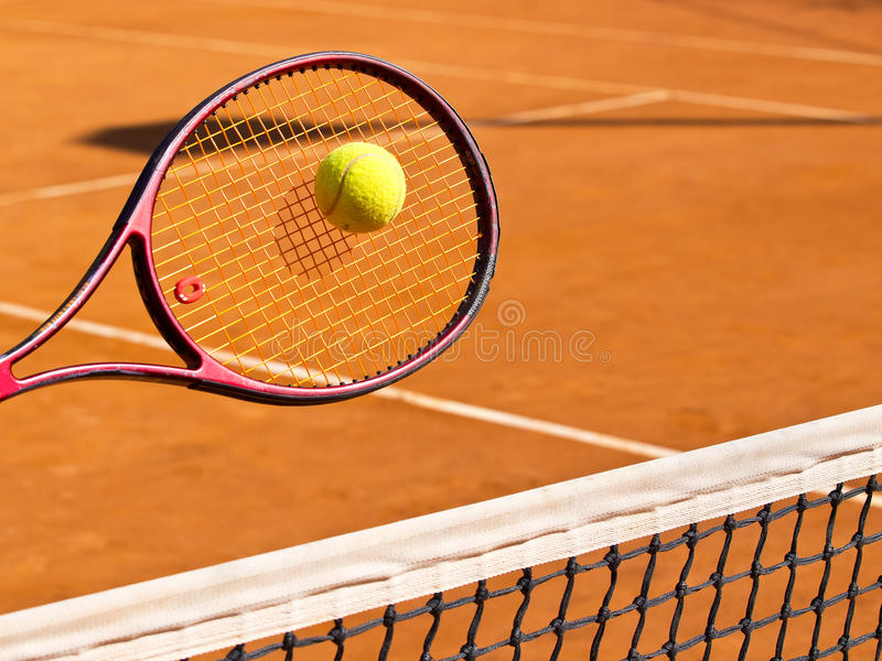 Tennis. Racket and the ball stock photography