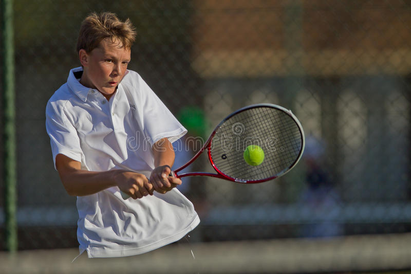 Tennis Player Ball Strike. Kearsney Tennis Festival . Close up telephoto action pictures of mature teenage male players hitting the ball with different styles of stock image