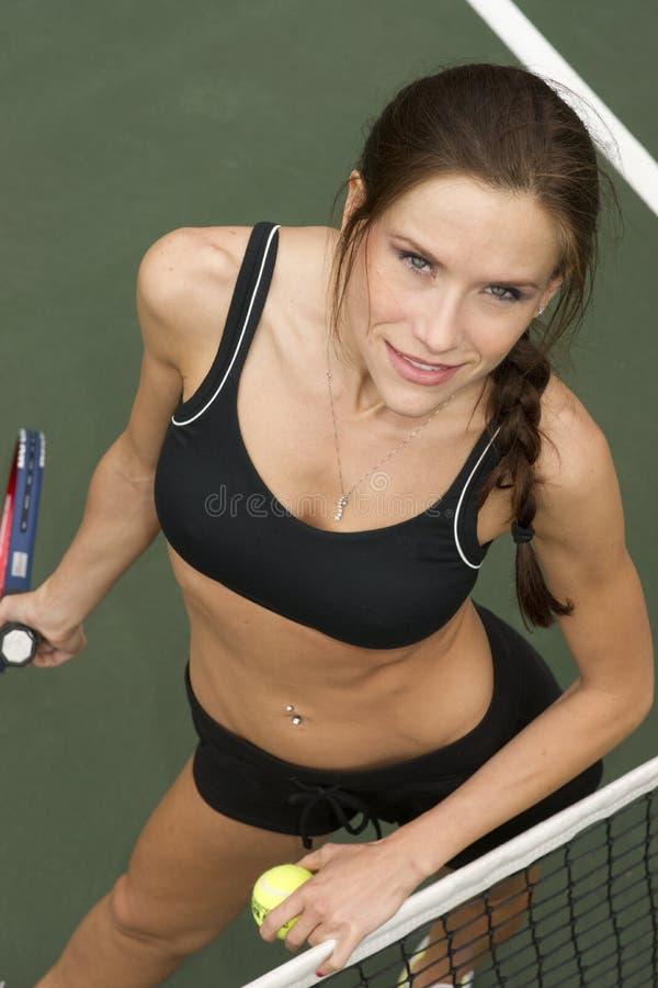 Beautiful Tennis Player Female at Court Net stock photos