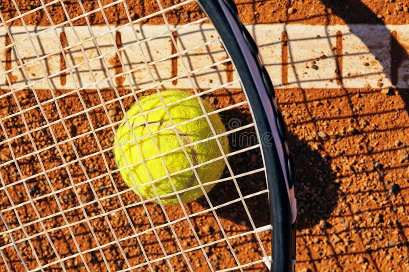 Tennis ball on a tennis court royalty free stock images