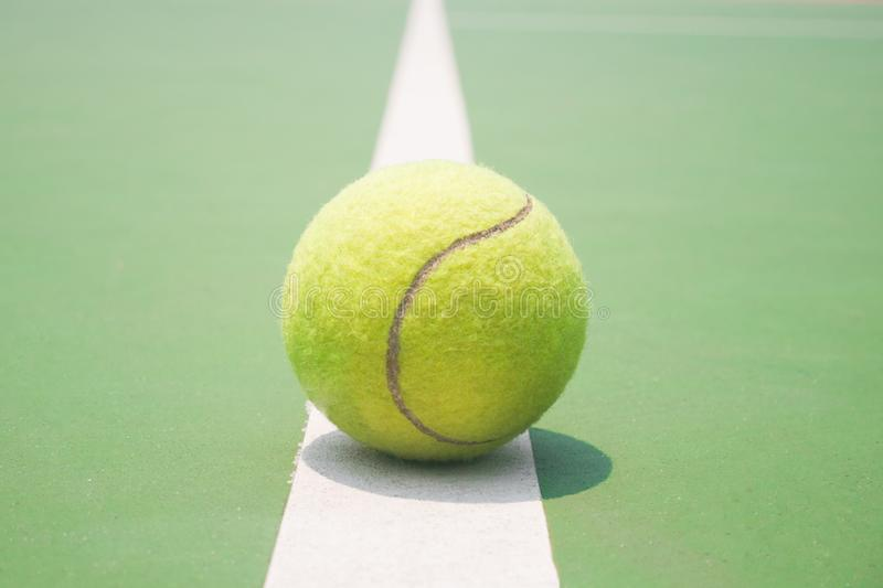 Tennis ball on the court royalty free stock image