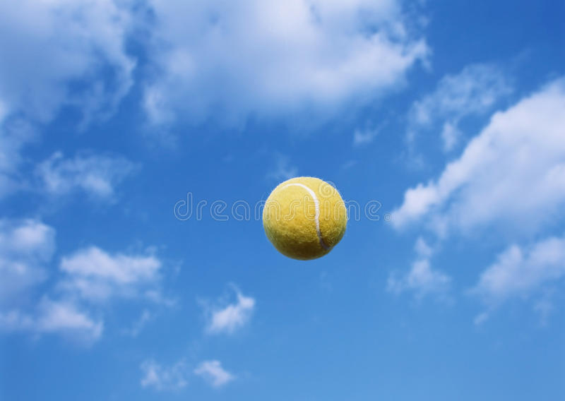Tennis ball flying. Through the sky royalty free stock image