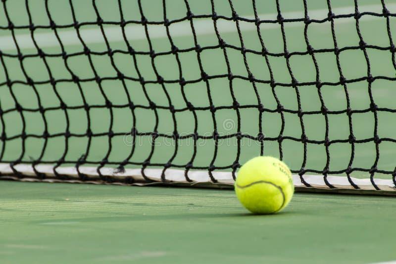 Tennis ball. On green tennis court stock photos