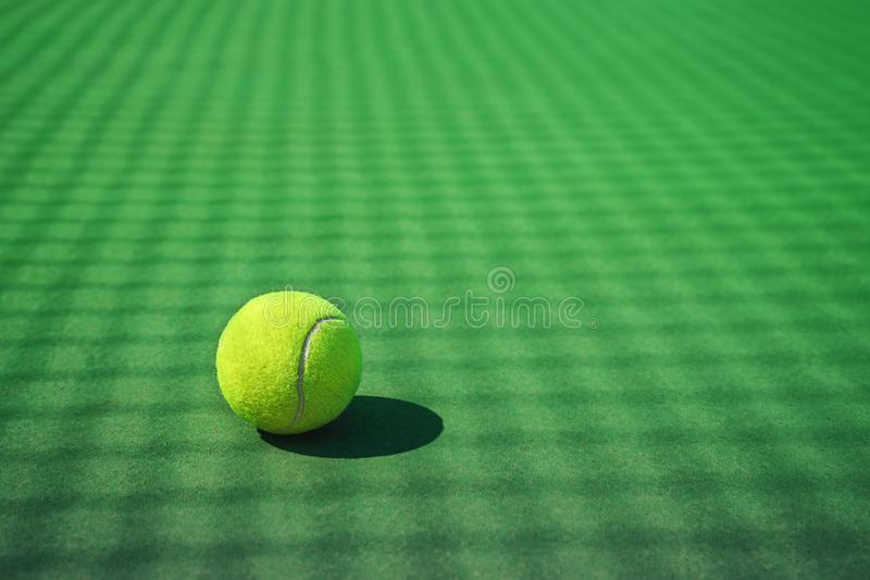 Tennis ball on the green court. royalty free stock photography