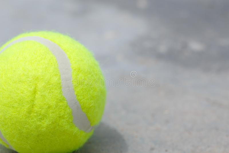 Tennis ball on the ground. Closeup detail stock photography