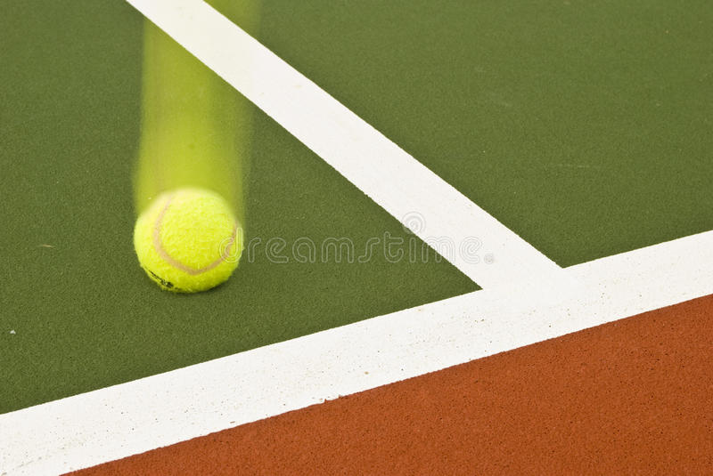 Tennis ball hits corner. Tennis ball hitting the corner of the tennis court for a point stock photos