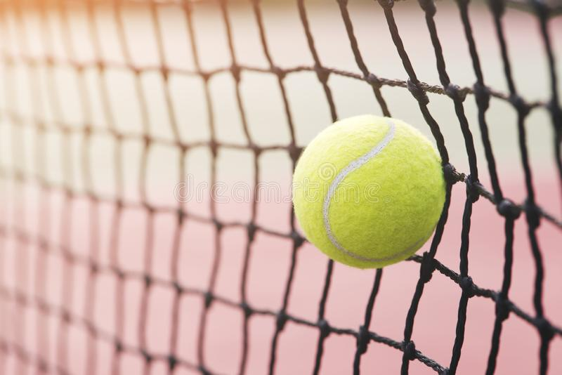 Tennis ball hitting the tennis net at tennis court. stock photos