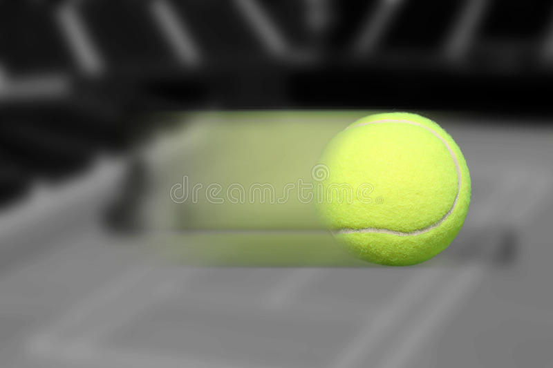 Tennis Ball Moving. Motion blur on background black and white royalty free stock photography