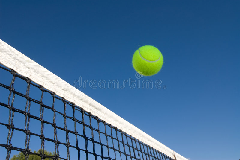 Tennis ball and net royalty free stock images
