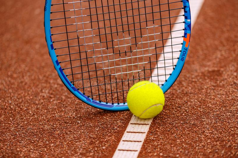 Tennis ball and racket. On red ground stock image