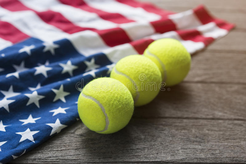 Tennis balls with an American flag on wood table. Close up stock photo