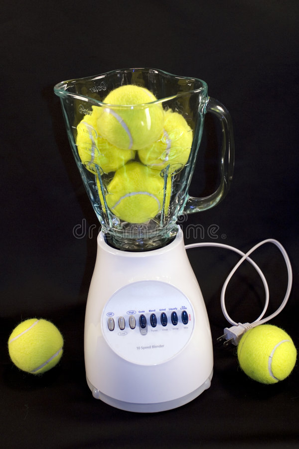 Tennis balls in blender royalty free stock photos