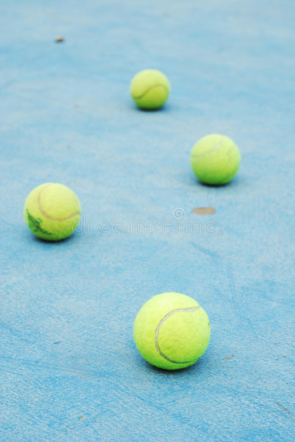 Tennis balls on court field royalty free stock images