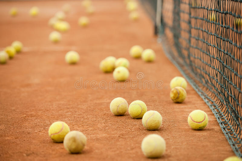 Tennis balls on a field royalty free stock photography