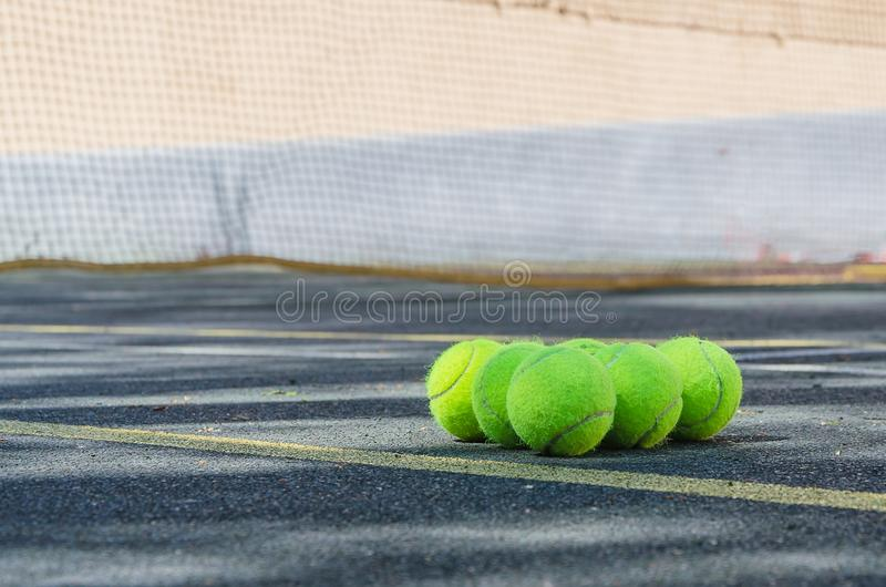 Tennis balls lying on the field. royalty free stock image