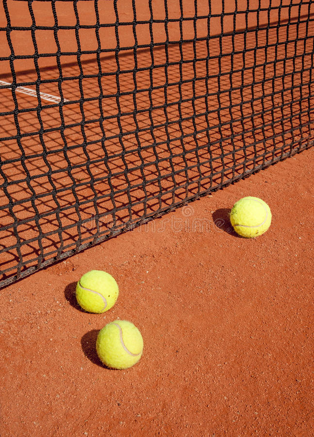 Tennis balls at the net royalty free stock photos