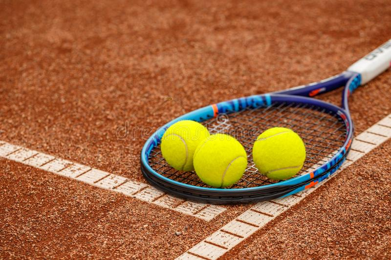 Tennis balls and racket. On red ground stock images