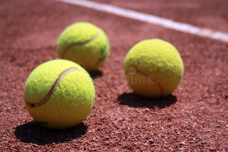 Tennis balls on field stock photography
