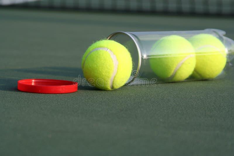 Tennis balls on tennis court royalty free stock image