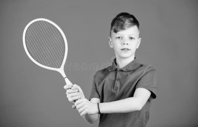 Tennis club. Tennis player with racket. Childhood activity. Little boy. Fitness diet brings health and energy. Gym. Workout of teen boy. Sport game success stock images