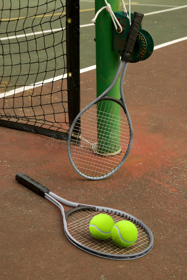 Tennis court with balls and ra stock photography