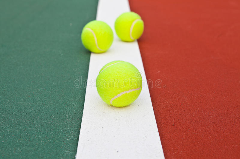 Download Tennis Court At Base Line With Ball Stock Photo - Image: 25594548