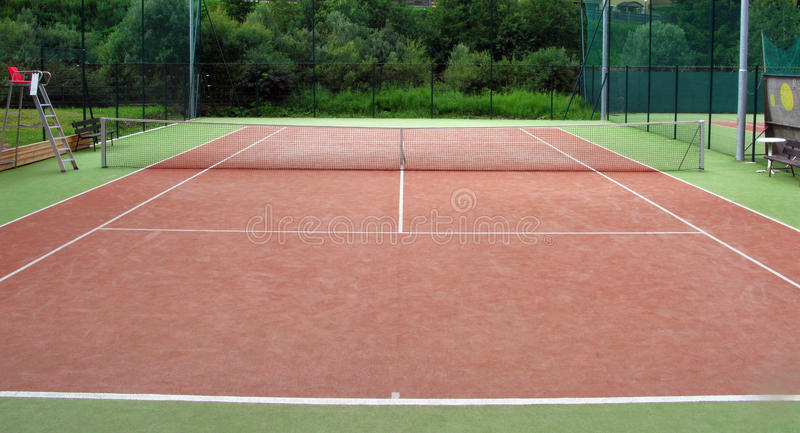 Tennis court detail. Red tennis court on mountain resort stock images