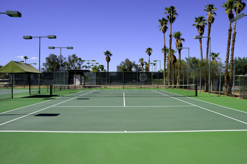 Tennis court. A green tennis court on a summer day royalty free stock images