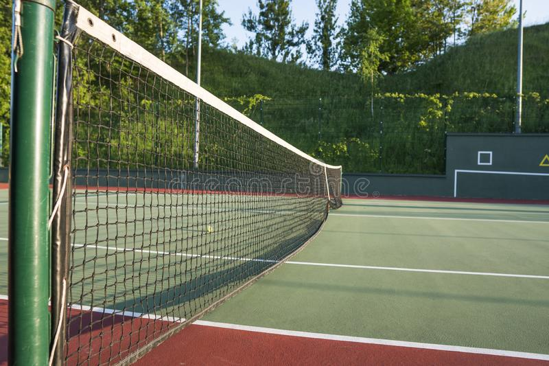 Tennis court net close up in sunny day. Tennis court net close up in sunny day stock photography
