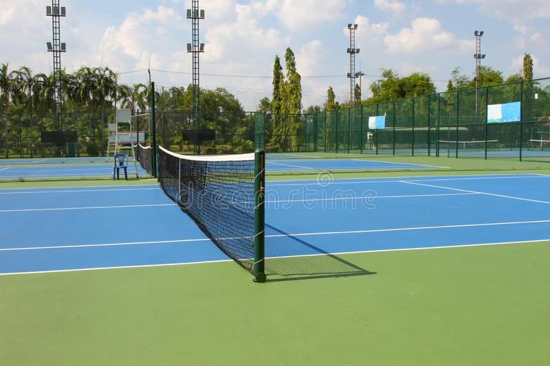 Tennis court outdoors with net in daylights.  stock photo