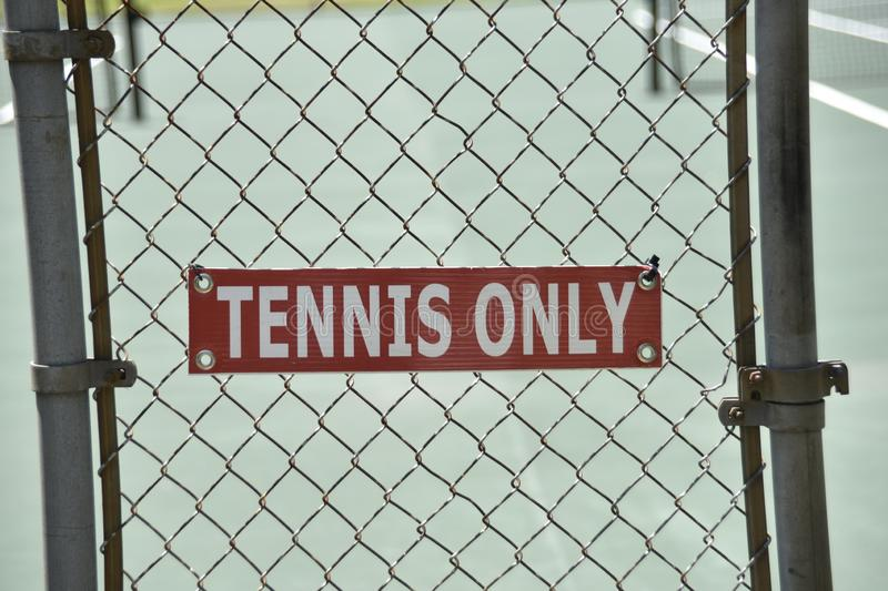 Tennis Court for Singles or Doubles Play. Tennis is a racket sport that can be played individually against a single opponent singles or between two teams of two royalty free stock photo