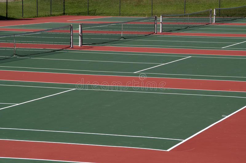 Tennis Courts. Ready and waiting for players royalty free stock photography
