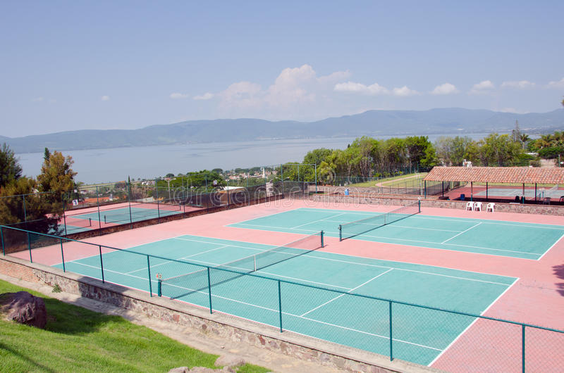 Tennis Courts. Resort tennis courts in mountains overlooking lake stock photos