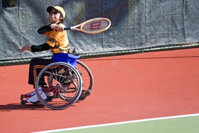 Tennis della presidenza di rotella per le persone invalide (donne) fotografie stock libere da diritti