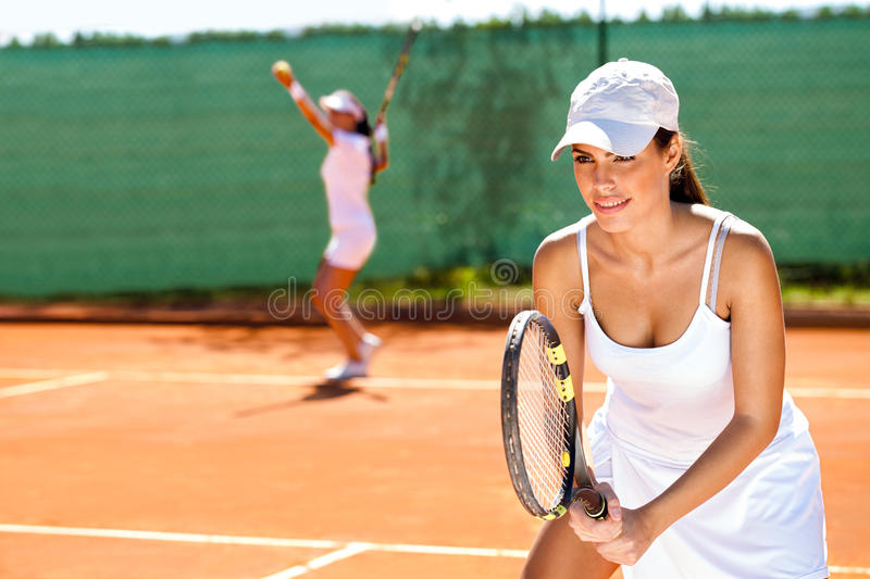 Tennis doubles. Two tennis player playing doubles at tennis court stock photography