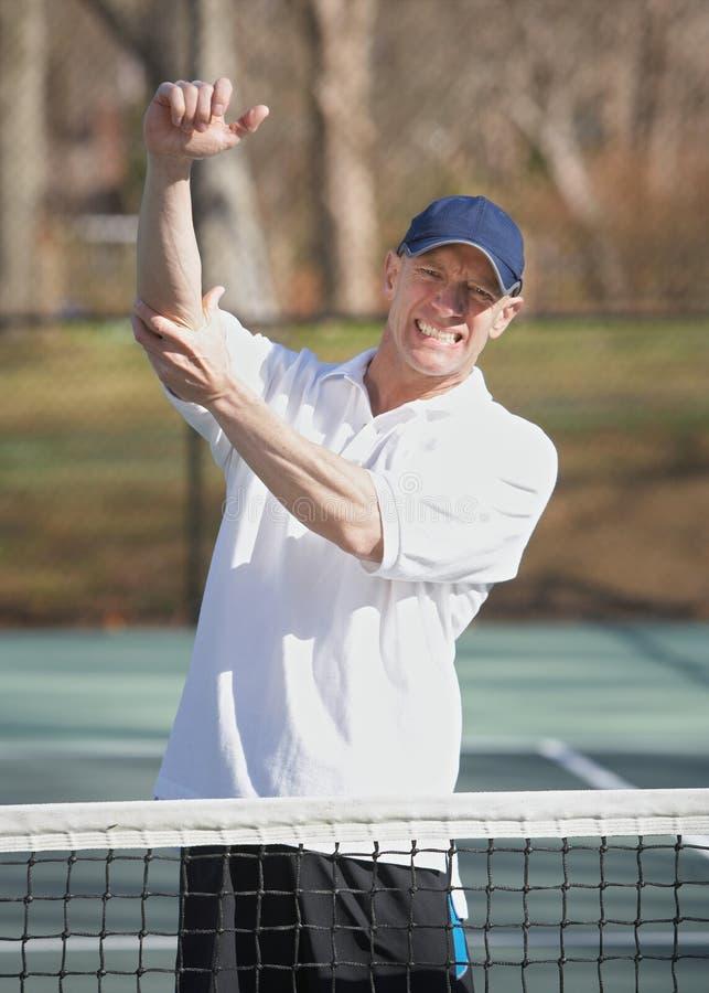 Tennis elbow pain stock photography