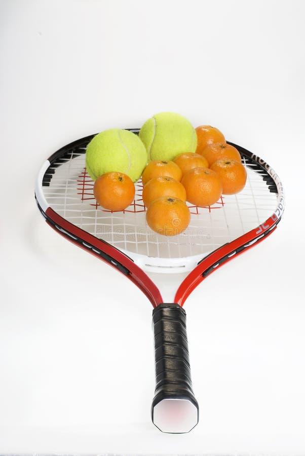 Tennis en mandarijnen. royalty-vrije stock fotografie
