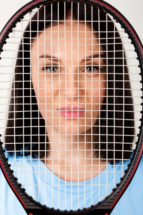 Tennis femminile con la racchetta di tennis immagine stock libera da diritti