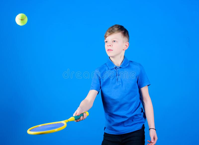 Tennis is fun. Gym workout of teen boy. Little boy. Fitness diet brings health and energy. Tennis player with racket and. Ball. Childhood activity. Sport game royalty free stock image