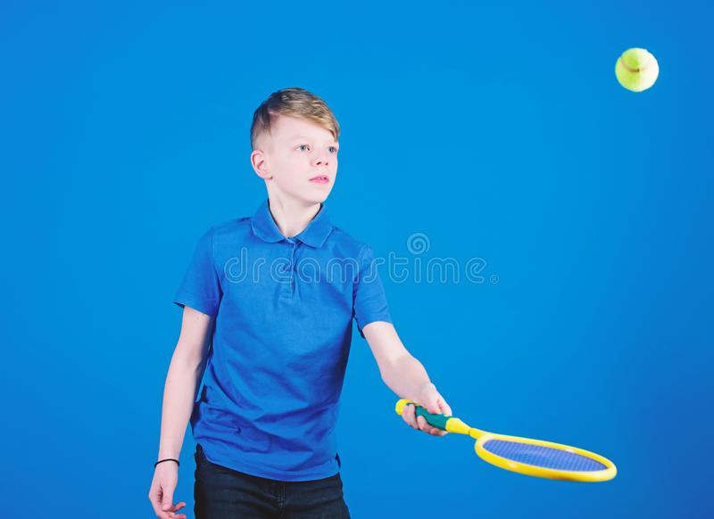 Tennis is fun. Gym workout of teen boy. Little boy. Fitness diet brings health and energy. Tennis player with racket and. Ball. Childhood activity. Sport game stock images