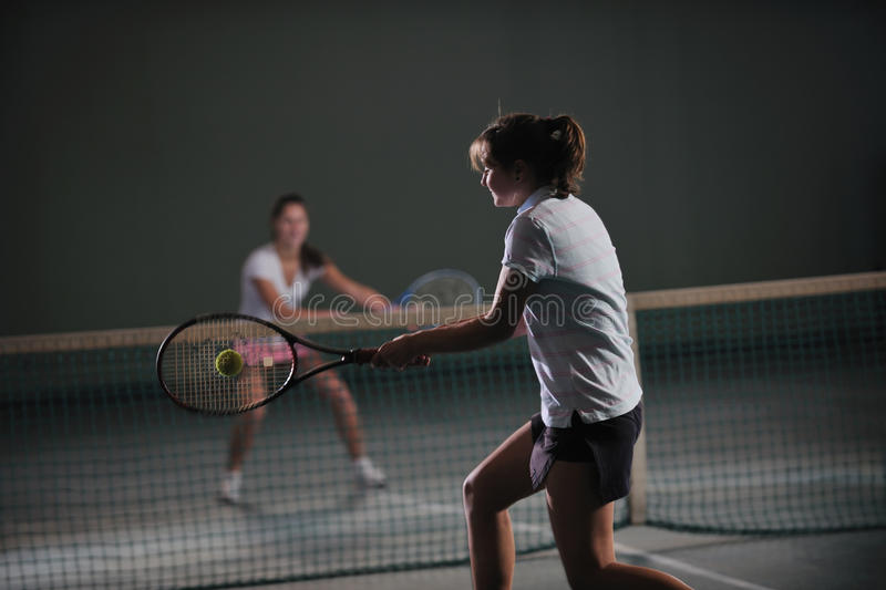 Tennis girl. Young girl exercise tennis sport indoor stock images
