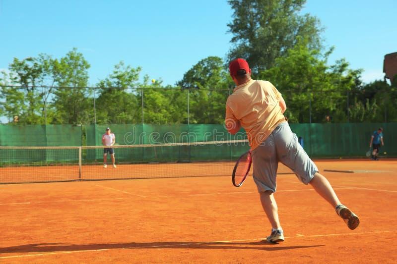 Tennis match. Player served tennis ball info net royalty free stock image