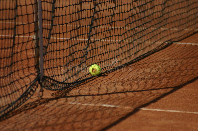 Tennis net and ball stock images